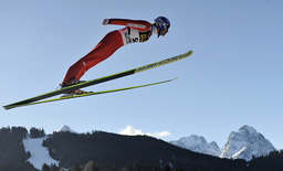 Norway's ski jumper Jacobsen soars over the Zugspitze and Waxenstein mountain during practice for second event of four-hills ski jumping tournament in Garmisch Partenkirchen