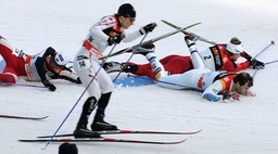 Canada's Kershaw skis in front of crashed Northug and Pettersen from Norway and Sweden's Fredriksson during the first of four 'Tour de Ski' Cross Country World Cup competitions in Munich's Olympic stadium