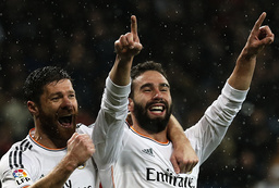 Real Madrid's Carbajal celebrates his goal against Rayo Vallecano with his team mate Alonso during Spanish First Division match in Madrid