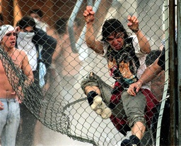 RIOTING SOCCER FANS TRY TO BREAK THROUGH FENCE ONTO PLAYING FIELD