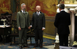 Gay couple Wale and Allard hold hands as they take their vows in the first same-sex wedding in Brighton