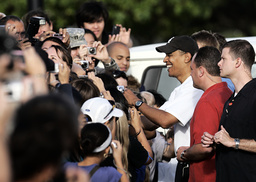 US President-elect Obama greets the crowd after working out at the Semper Fit gym on Marine Corps Base Hawaii in Kailua, Hawaii.