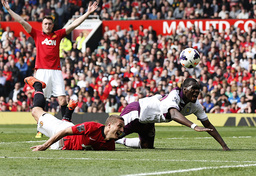 Manchester United's Vidic challenges Aston Villa's Benteke during their English Premier League soccer match at Old Trafford in Manchester