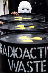 ANTI-NUCLEAR PROTESTER HIDES BEHIND MOCK DRUM OF RADIO ACTIVE WASTE AT ANT-NUCLEAR ACTION IN SYDNEY
