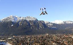 Switzerland's Ammann soars over the city of Garmisch-Partenkirchen during practice for second event of four-hills ski jumping tournament