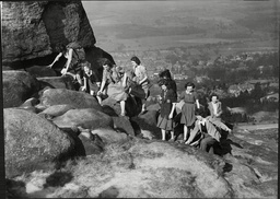 A Party Of Ramblers Enjoying The Easter Sunshine On The Cow & Calf Rocks At Ilkley Yorkshire.