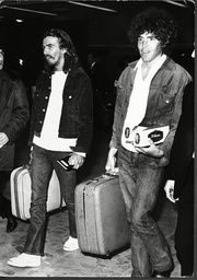George Harrison And His Personal Assistant Terry Doran Arriving At London Airport After 3 Weeks Holiday In Sardinia 1969