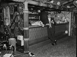 Stanley Lowe Has A Lonely Wait At The Trader Vic's Bar At The Hilton Hotel