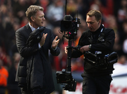 Manchester United's manager Moyes applauds ahead their English Premier League soccer match againmst Aston Villa at Old Trafford in Manchester