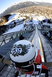 Norway's Romoeren prepares to speed down the ski jump during practice for second event offour-hills ski jumping tournament in Garmisch-Partenkirchen