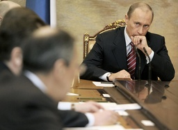 Russia's President Putin looks at his ministers as he takes part in a cabinet session in Moscow