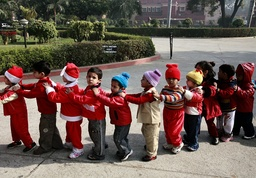 School children line-up outside a church ahead of Christmas in New Delhi