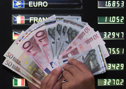 A LONDON BANK WORKER HOLDS EURO NOTES PRIOR TO THEIR LAUNCH IN JANUARY