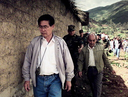PERUVIAN PRESIDENT FUJIMORI WALKS PAST RUINS OF VILLAGE IN PERU