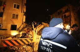 Rescuers work at shattered five-storey block in Black Sea resort of Yevpatoria in Crimea peninsula