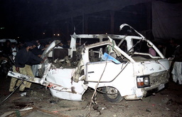 POLICE INSPECT A VEHICLE WRECKED BY BOMB IN LAHORE