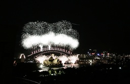 Fireworks explode over the Sydney Opera House and Harbour Bridge during New Year's celebrations