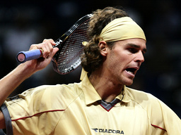 GUSTAVO KUERTEN OF BRAZIL LOOSES IN FIRST ROUND IN BASLE.
