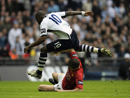 Manchester United's Evans tackles Tottenham Hotspur's Bent during their English League Cup final soccer match in London