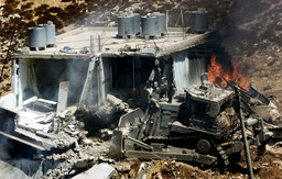 ISRAELI ARMY BULDOZER DESTROYS HOUSE BELONGING TO ISLAMIC JIHAD MILITANT DURING OPERATION IN DURA