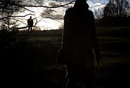 Man watching woman