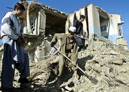 BAGRAM RESIDENTS CLEAR DEBRIS FROM DESTROYED HOUSE