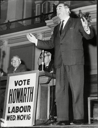 George Brown Labour Politician On Stage Addressing Audience While Next To A Poster Reading Vote Howarth 1960.