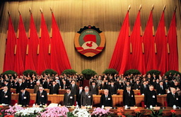 MEMBERS OF CPPCC BOW AS THEY HONOUR DENG XIAOPING IN BEIJING