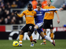 Chelsea's Fernando Torres challenges Wolverhampton Wanderers' Emmanuel Frimpong during their English Premier League soccer match at Molineux in Wolverhampton